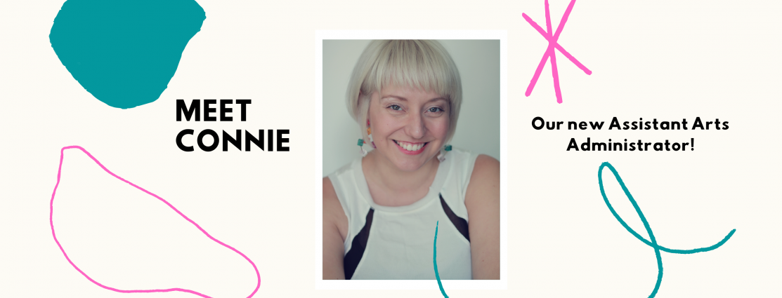 A banner with a photo of Connie, a blonde person sitting and smiling directly at the camera. Colourful design elements surround the photo with the words Meet Connie our new Assistant Arts Administrator!